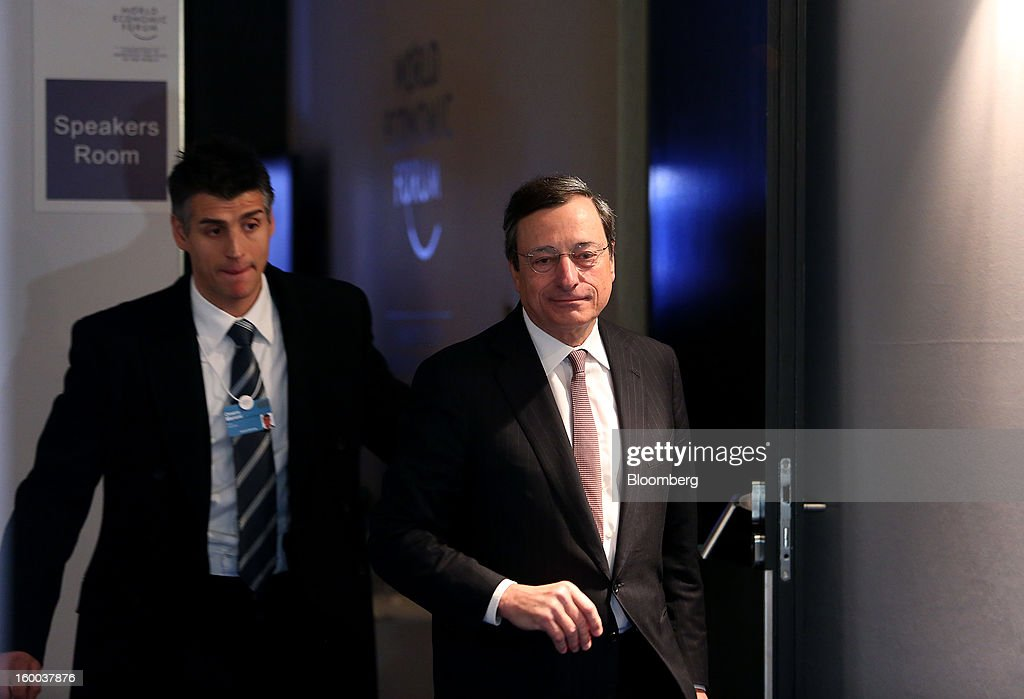 Mario Draghi, president of the European Central Bank (ECB), right, arrives to speak at a session on day three of the World Economic Forum (WEF) in Davos, Switzerland, on Friday, Jan. 25, 2013. World leaders, influential executives, bankers and policy makers attend the 43rd annual meeting of the World Economic Forum in Davos, the five day event runs from Jan. 23-27. Photographer: Chris Ratcliffe/Bloomberg via Getty Images