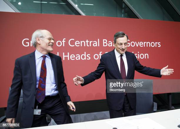 Mario Draghi president of the European Central Bank right gestures as Stefan Ingves governor of the Sveriges Riksbank and chairman of the Basel...