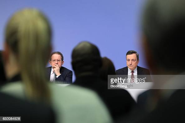 Mario Draghi president of the European Central Bank right sits beside Vitor Constancio vice president of the European Central Bank during a news...