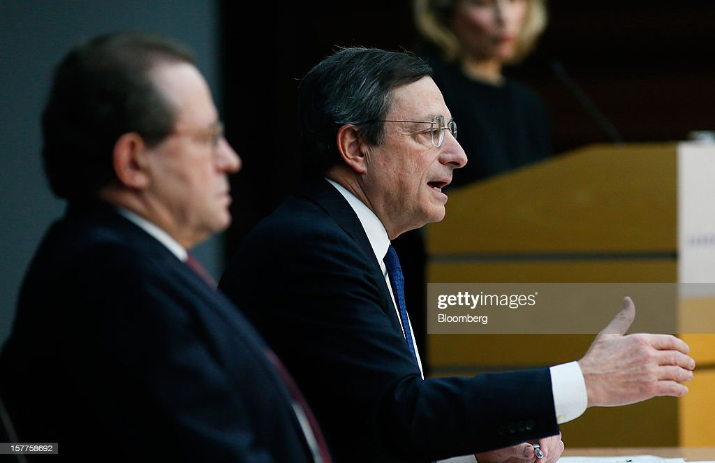 <a gi-track='captionPersonalityLinkClicked' href=/galleries/search?phrase=Mario+Draghi&family=editorial&specificpeople=571678 ng-click='$event.stopPropagation()'>Mario Draghi</a>, president of the European Central Bank (ECB), right, speaks during a news conference at the bank's headquarters in Frankfurt, Germany, on Thursday, Dec. 6, 2012. The European Central Bank cut its economic and inflation forecasts and Draghi said weakness will persist into next year, leaving the door ajar for further interest-rate cuts. Photographer: Ralph Orlowski/Bloomberg via Getty Images