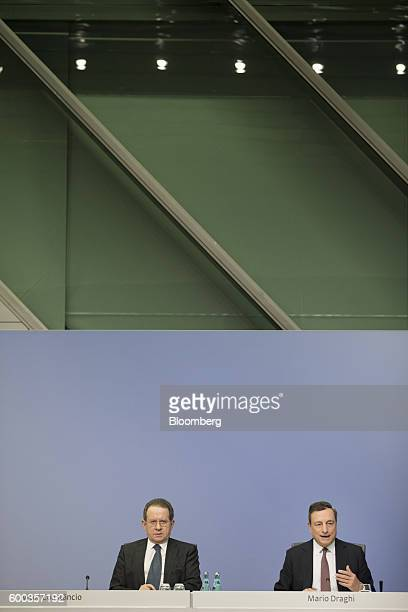Mario Draghi president of the European Central Bank right speaks as Vitor Constancio vice president of the European Central Bank looks on during a...