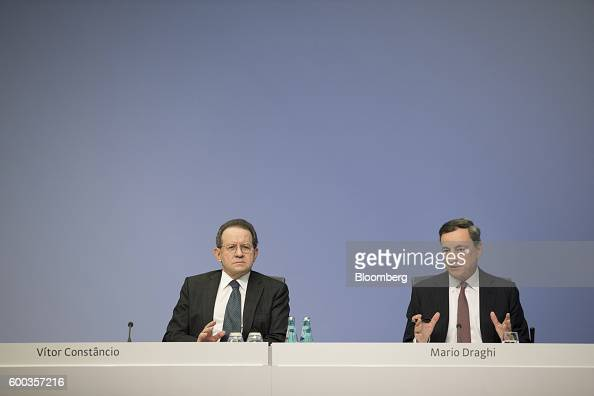 Mario Draghi president of the European Central Bank right speaks as Vitor Constancio vice president of the European Central Bank looks on during a a...