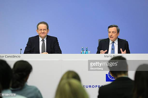 Mario Draghi president of the European Central Bank right speaks as Vitor Constancio vice president of the European Central Bank reacts during a news...