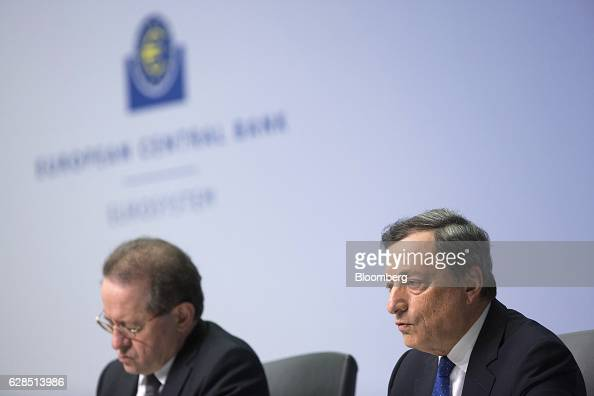Mario Draghi president of the European Central Bank right speaks as he sits beside Vitor Constancio vice president of the European Central Bank...
