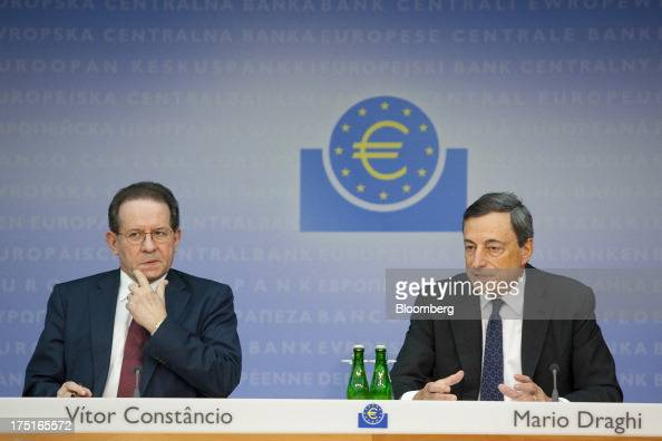 Mario Draghi president of the European Central Bank right speaks while Vitor Constancio vice president of the European Central Bank listens during a...