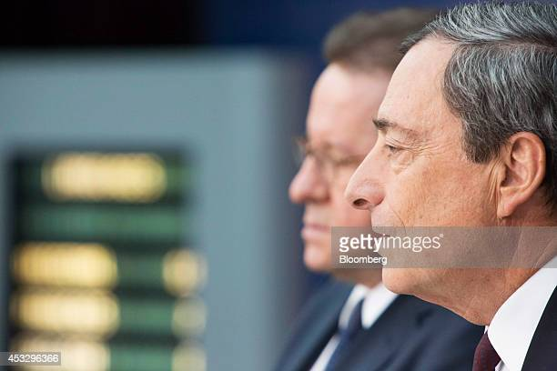 Mario Draghi president of the European Central Bank right speaks beside Vitor Constancio vice president of the European Central Bank during a news...