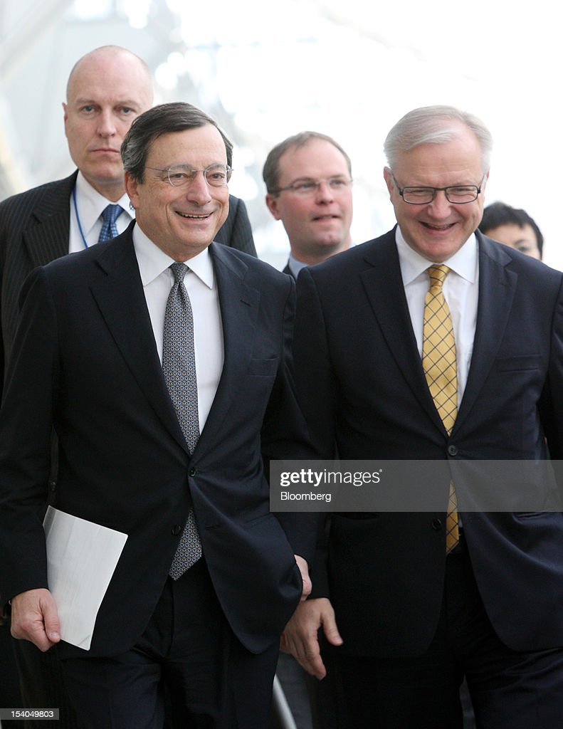 <a gi-track='captionPersonalityLinkClicked' href=/galleries/search?phrase=Mario+Draghi&family=editorial&specificpeople=571678 ng-click='$event.stopPropagation()'>Mario Draghi</a>, president of the European Central Bank (ECB), second from right, and <a gi-track='captionPersonalityLinkClicked' href=/galleries/search?phrase=Olli+Rehn&family=editorial&specificpeople=584845 ng-click='$event.stopPropagation()'>Olli Rehn</a>, economic and monetary affairs commissioner for the European Union (EU), right, walk to a news conference room at the Annual Meetings of the International Monetary Fund (IMF) and the World Bank Group in Tokyo, Japan, on Saturday, Oct. 13, 2012. The world's finance ministers and central bank governors are gathered in Tokyo for the annual meetings of the IMF and the World Bank as the rebound from the deepest global recession since World War II stagnates. Photographer: Tomohiro Ohsumi/Bloomberg via Getty Images