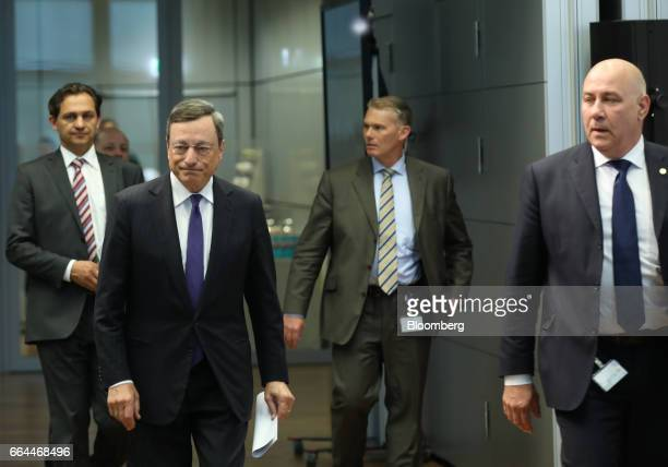 Mario Draghi president of the European Central Bank second left arrives to unveil the new 50 euro currency bank note at the ECB headquarters in...