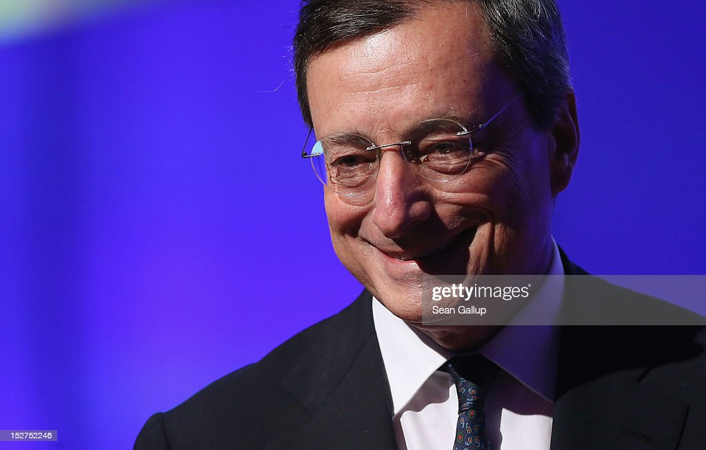 <a gi-track='captionPersonalityLinkClicked' href=/galleries/search?phrase=Mario+Draghi&family=editorial&specificpeople=571678 ng-click='$event.stopPropagation()'>Mario Draghi</a>, president of the European Central Bank (ECB), speaks at a conference of the German Federation of Industry (BDI) on September 25, 2012 in Berlin, Germany. Draghi met with German Chancellor Angela Merkel shortly before.