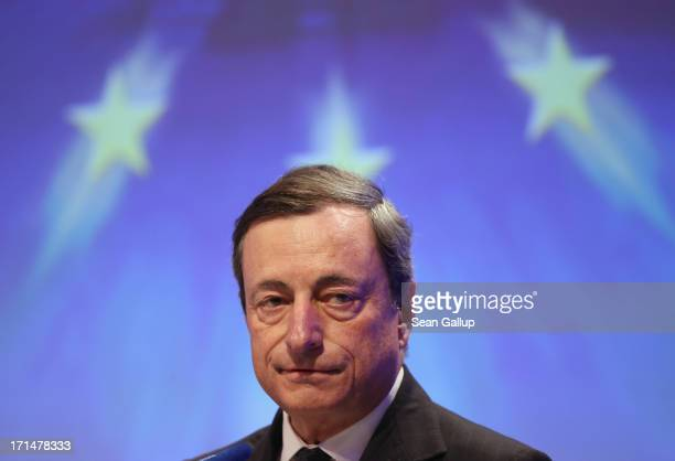 Mario Draghi president of the European Central Bank speaks at the 2013 German Economic Council conference on June 25 2013 in Berlin Germany The...