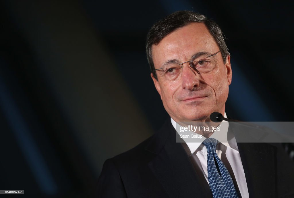 <a gi-track='captionPersonalityLinkClicked' href=/galleries/search?phrase=Mario+Draghi&family=editorial&specificpeople=571678 ng-click='$event.stopPropagation()'>Mario Draghi</a>, President of the European Central Bank (ECB), speaks to the media at the Bundestag after he spoke to German parliamentarians on October 24, 2012 in Berlin, Germany. Draghi spoke to the Bundestag members to defend his European bond-buying plan, a move many in Germany fear will fuel inflation.