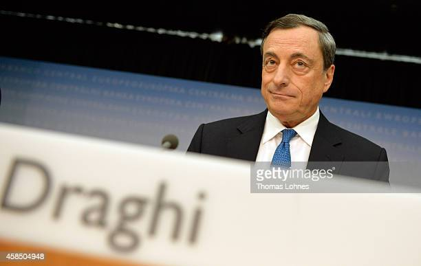 Mario Draghi President of the European Central Bank speaks to the media following the monthly ECB board meeting on November 6 2014 in Frankfurt...