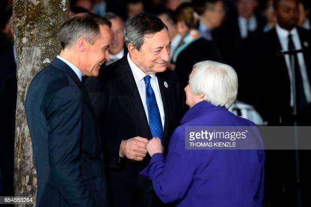Mario Draghi President of the European Central Bank speaks with Janet Yellen Chair of the Board of Governors of the Federal Reserve System and the...