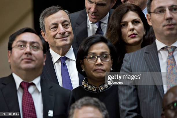 Mario Draghi president of the European Central Bank top left stands during an International Monetary Fund governors group photo at the International...