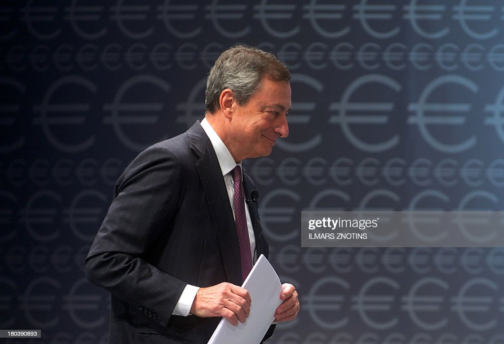 Mario Draghi, President of the European Central Bank walks on stage during the 'Euro Conference Latvia' in Riga, Latvia, on September 12, 2013. Latvia will replace its current currency the Lat by the Euro in January 2014.