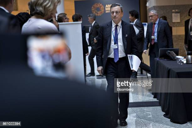 Mario Draghi president of the European Central Bank walks out of an International Monetary Fund Committee opening session during the International...