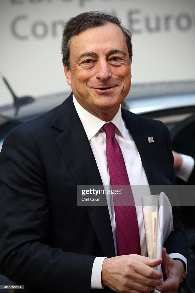 Mario Draghi, the President of the European Central Bank, arrives at the headquarters of the Council of the European Union on the second day of a two-day European Council meeting on October 24, 2014 in Brussels, Belgium. Alongside criticism from outgoing European Commission president Jose Manuel Barroso on the UK's stance on EU immigration and a plan to quit the European Court of Human Rights, the UK has been told to pay an extra 1.7bn GBP (2.1bn EUR) towards the EU's budget because its economy has performed better than expected.