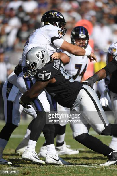 Mario Edwards of the Oakland Raiders hits Joe Flacco of the Baltimore Ravens during their NFL game at OaklandAlameda County Coliseum on October 8...
