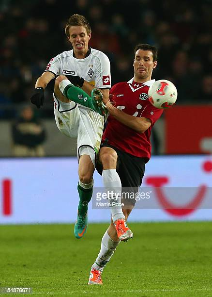 Mario Eggimann of Hannover and Patrick Herrmann of Gladbach battle for the ball during the Bundesliga match between Hannover 96 and Borussia...