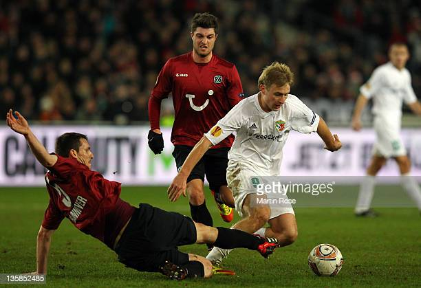 Mario Eggimann of Hannover and Roman Bezus of Poltava battle for the ball during the UEFA Europa League Group B match between Hannover 96 and FC...