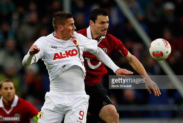 Mario Eggimann of Hannover and Torsten Oehrl of Augsburg fight for the ball during the Bundesliga match between Hannover 96 and FC Augsburg at AWD...