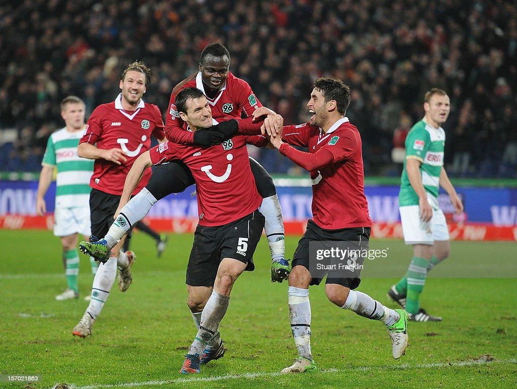 Mario Eggimann of Hannover celebrates scoring the second goal with Didier Ya Konan and Karim Haggui during the Bundesliga match between Hannover 96 and SpVgg Greuther Fuerth at AWD Arena on November 27, 2012 in Hannover, Germany.