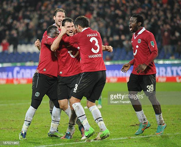 Mario Eggimann of Hannover celebrates scoring the second goal with Didier Ya Konan and Karim Haggui during the Bundesliga match between Hannover 96...