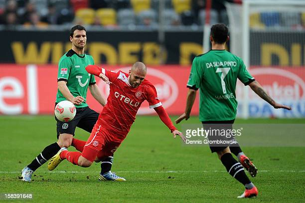 Mario Eggimann of Hannover challenges Dani Schahin of Duesseldorf during the Bundesliga match between Fortuna Duesseldorf 1895 and Hannover 96 at...