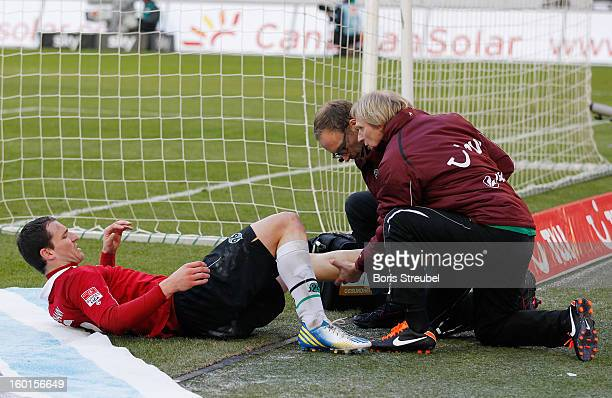 Mario Eggimann of Hannover lies injured on the ground during the Bundesliga match between Hannover 96 and VfL Wolfsburg at AWD Arena on January 26...