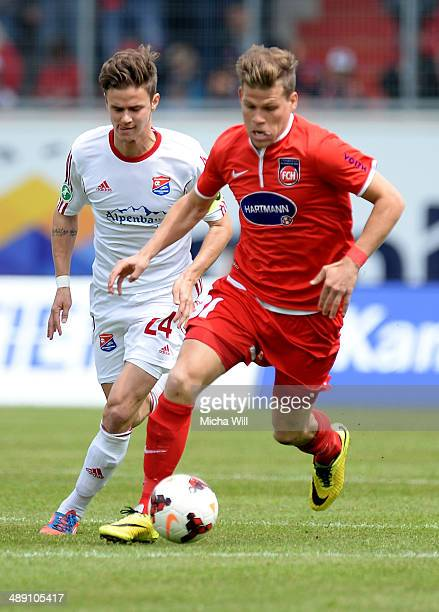 Mario Erb of Unterhaching challenges Florian Niederlechner of Heidenheim during the Third League match between 1 FC Heidenheim and SpVgg Unterhaching...