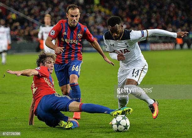 Mario Fernandes and Bibras Natcho of CSKA Moscow vies for the ball with GeorgesKvin N'Koudou of Tottenham Hotspur FC during the UEFA Champions League...