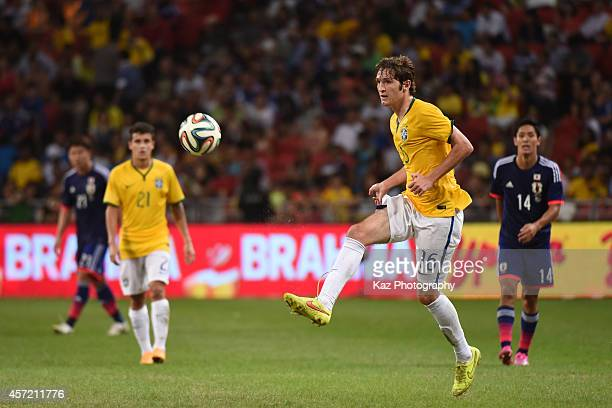 Mario Fernandes of Brazil passes the ball during the international friendly match between Japan and Brazil at the National Stadium on October 14 2014...