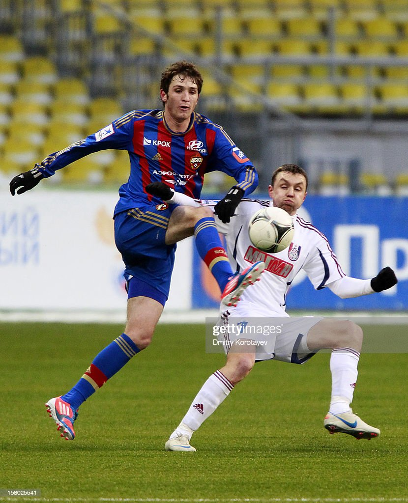 Mario Fernandes (L) of PFC CSKA Moscow battles for the ball with Anton Bober of FC Mordovia Saransk during the Russian Premier League match between PFC CSKA Moscow and FC Mordovia Saransk at the Luzhniki Stadium on December 09, 2012 in Moscow, Russia.