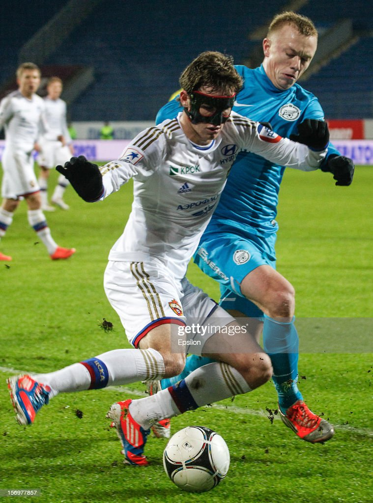 Mario Fernandes (L) of PFC CSKA Moscow vies for the ball with Renat Yanbaev of FC Zenit St. Petersburg during the Russian Football League Championship match between FC Zenit St. Petersburg and PFC CSKA Moscow at the Petrovsky Stadium on November 26, 2012 in St. Petersburg, Russia.