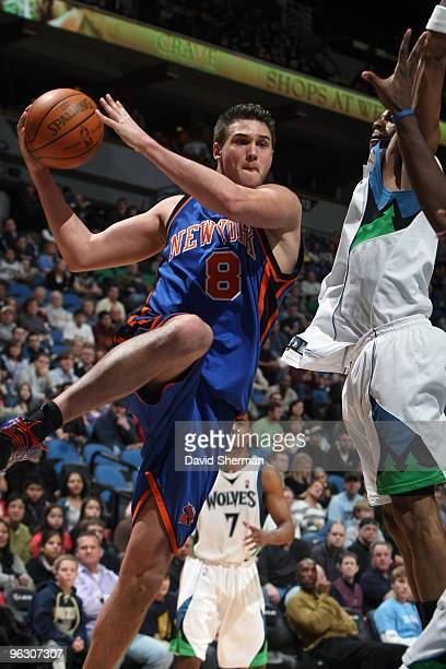 Mario Gallinari of the New York Knicks passes against Wayne Ellington of the Minnesota Timberwolves during the game on January 31 2010 at the Target...