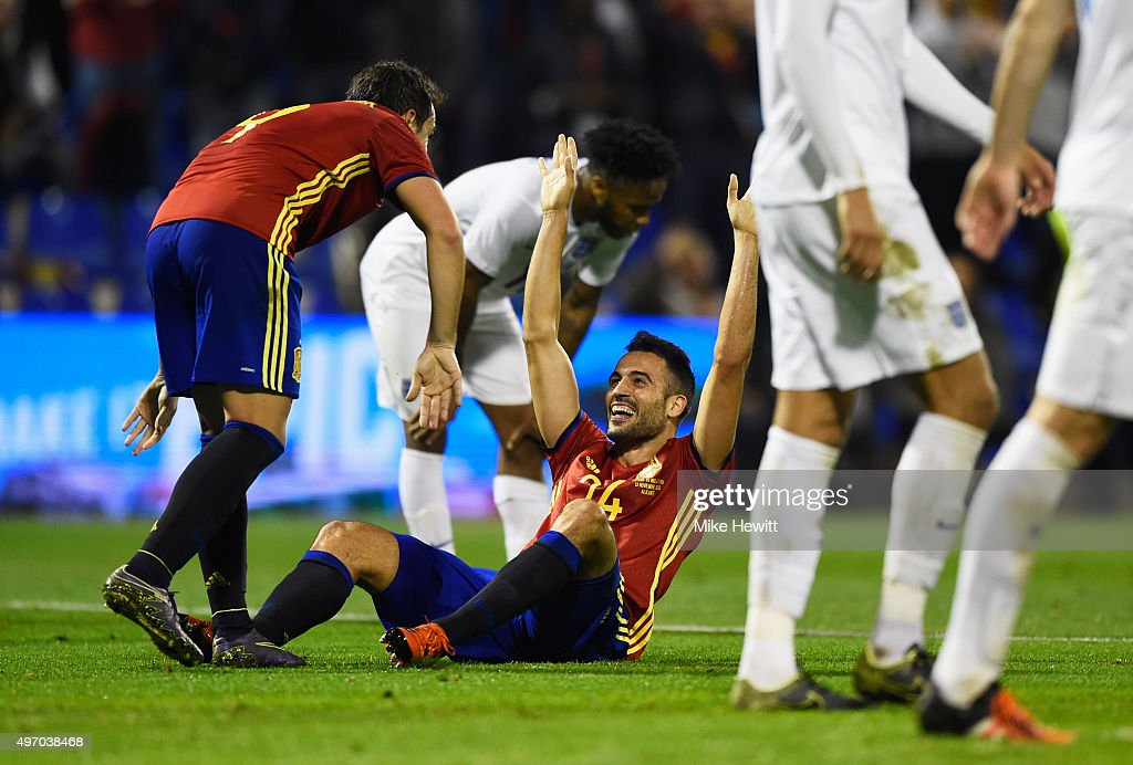 Mario Gaspar of Spain (24) celebrates with Paco Alcacer Garcia (9) as he scores their first goal during the international friendly match between Spain and England at Jose Rico Perez Stadium on November 13, 2015 in Alicante, Spain.