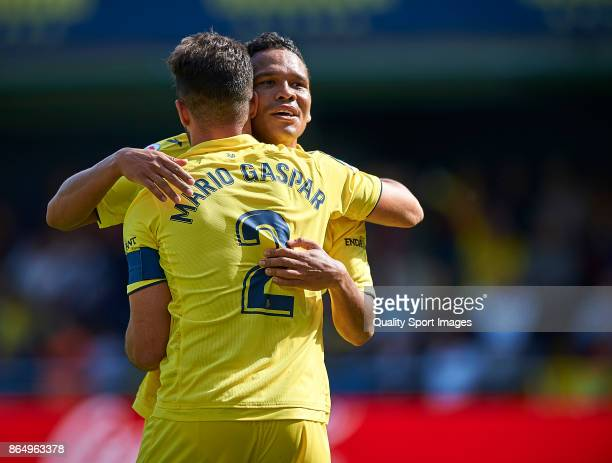Mario Gaspar of Villarreal celebrates with Carlos Bacca of Villarreal after scoring the second goal during the La Liga match between Villarreal and...