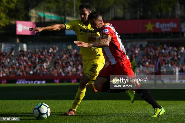 Mario Gaspar of Villarreal CF competes for the ball with Aday Benitez of Girona FC during the La Liga match between Girona and Villarreal at Estadi...