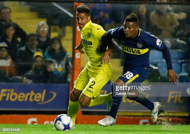 Mario Gaspar of Villarreal CF fights for the ball with Frank Fabra of Boca Juniors during the international friendly match between Boca Juniors and...