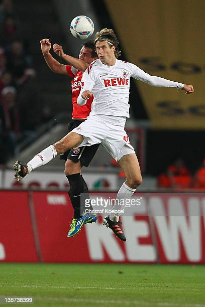 Mario Gavranovic of Mainz and Martin Lanig of Koeln go up for a header during the Bundesliga match between 1 FC Koeln and FSV Mainz 05 at...