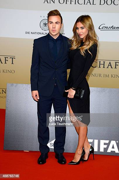 Mario Goetze and AnnKathrin Broemmel attend 'Die Mannschaft' Premiere In Berlin on November 10 2014 in Berlin Germany