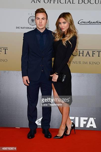 Mario Goetze and AnnKathrin Broemmel attend 'Die Mannschaft' Premiere In Berlin on November 10 2014 in Berlin Germany