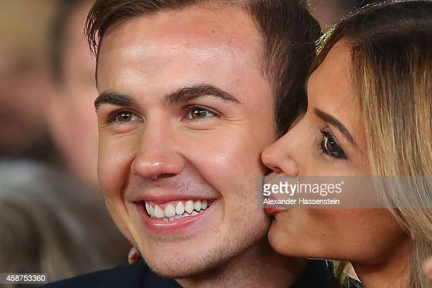 Mario Goetze and his girlfriend AnnKathrin Broemmel arrives for the movie premiere 'Die Mannschaft' at Sony Center Berlin on November 10 2014 in...