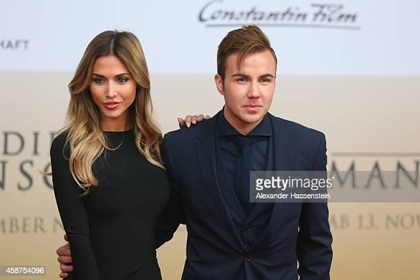 Mario Goetze and his girlfriend AnnKathrin Broemmel arrives for the movie premiere 'Die Mannschaft' at Sony Center Berlin on November 10 2014 in...