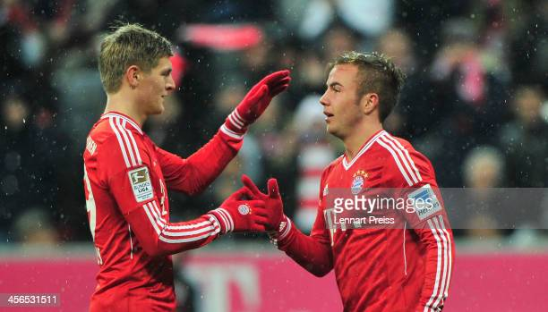 Mario Goetze and Toni Kroos of Muenchen celebrate their team's second goal during the Bundesliga match between FC Bayern Muenchen and Hamburger SV at...