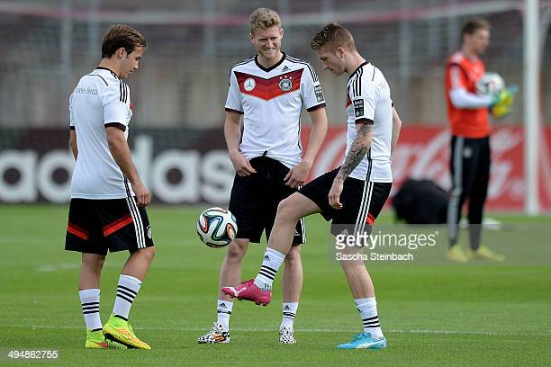 Mario Goetze Andre Schuerrle and Marco Reus of Germany warm up during a training session of the German national football team at Paul Janes Stadion...
