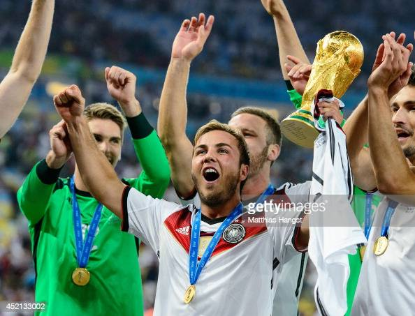 Mario Goetze celebrate with the World Cup trophy after defeating Argentina 10 in extra time during the 2014 FIFA World Cup Brazil Final match between...