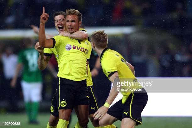 Mario Goetze celebrates the second goal with Robert Lewandowski and Marco Reus of Dortmund during the Bundesliga match between Borussia Dortmund and...