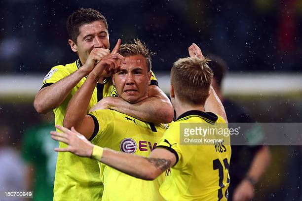 Mario Goetze celebrates the second goal with Robert Lewandowski and Marco Reus of Dortmund during the Bundesliga match between Borussia Dortmund and...