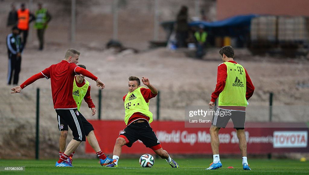 Mario Goetze dives for the ball during a Bayern Muenchen training session for the FIFA Club World Cup next to Agadir Stadium on December 16, 2013 in Agadir, Morocco.